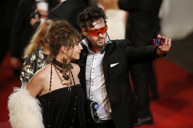 """Guests take a selfie on the red carpet as they arrive for the screening of the film """"Valley of Love"""" in competition at the 68th Cannes Film Festival in Cannes, southern France, May 23, 2015. (Photo by Benoit Tessier/Reuters)"""