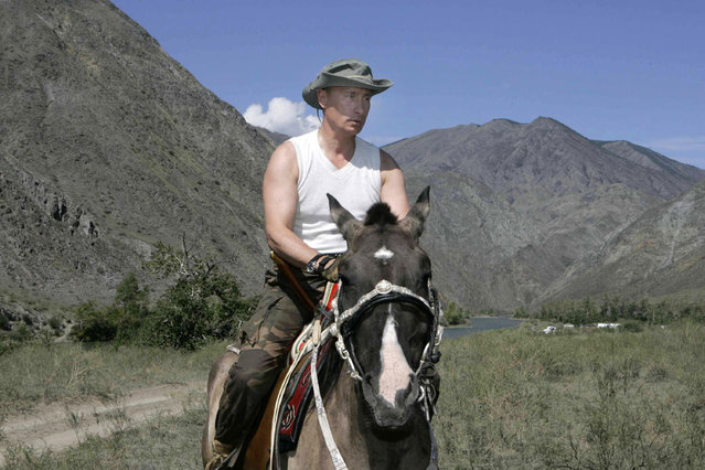 Russian President Vladimir Putin rides a horse near the Western Sayan Mountains in southern Siberia's Tuva region August 15, 2007. (Photo by Reuters/RIA Novosti)