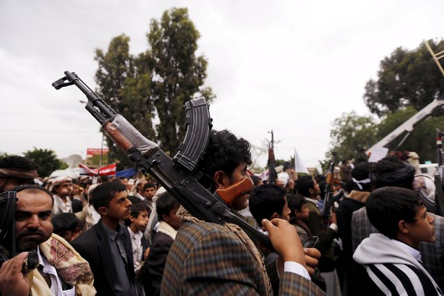 A Houthi follower shoulders his rifle during a demonstration against the Saudi-led air strikes, in Sanaa May 8, 2015. (Photo by Khaled Abdullah/Reuters)