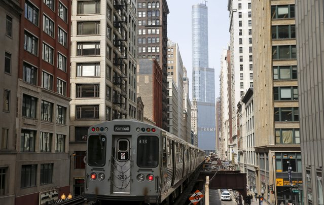 A subway car rides along the tracks towards The Trump International Hotel and Tower in downtown Chicago, Illinois, United States, April 18, 2016. (Photo by Jim Young/Reuters)