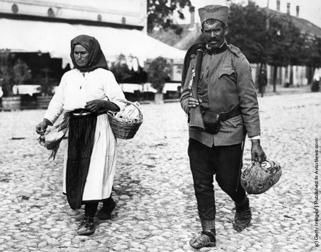 1914: A Serbian soldier of to the front is accompanied to the station by his wife