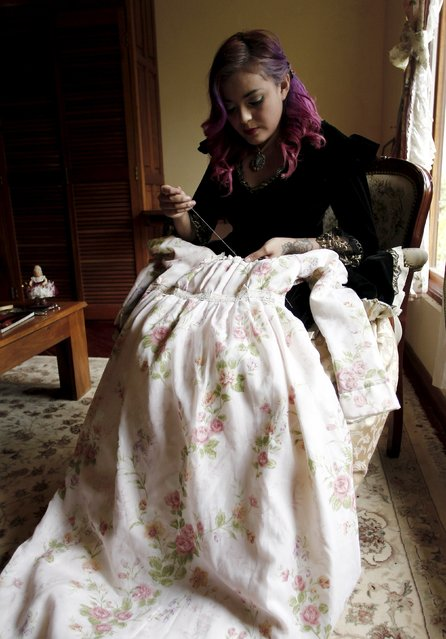"Adriana Barahona, known as "" Madame Barocle,"" wearing clothing of the Victorian era, sews a dress at her house in Heredia, Costa Rica June 4, 2015. Barahona says she has been passionate about clothing from the era of Britain's Queen Victoria (1837-1901), and has been making and wearing them since the age of 15. REUTERS/Juan Carlos Ulate"