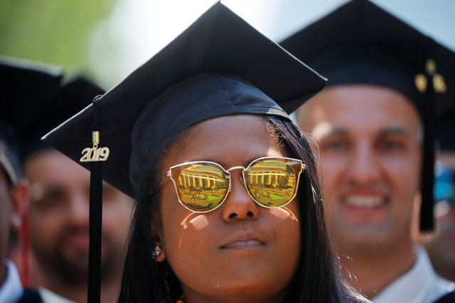 A graduating student listens as former New York City Mayor Michael Bloomberg delivers the Commencement Address during Commencement Exercises at the Massachusetts Institute of Technology (MIT) in Cambridge, Massachusetts, U.S., June 7, 2019. (Photo by Brian Snyder/Reuters)