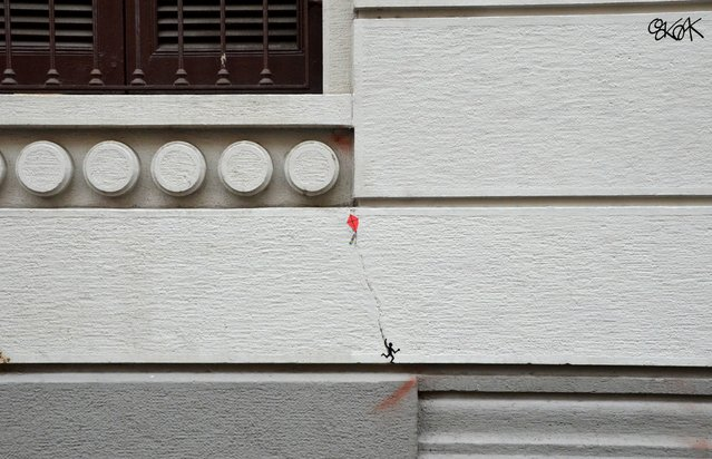 French street artist OakOak produces creative works of art that use the characteristics of a location such as a light post, road sign and even a crack in the wall as inspiration but also as key elements in the work.