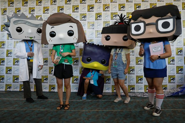 Attendees pose for a picture as they arrive in costumes to enjoy Comic Con International in San Diego, California, U.S., July 19, 2019. (Photo by Mike Blake/Reuters)