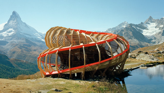 Evolver, Zermatt, Switzerland, by Alice Studio/EPFL. There's more than one way to enter this temporary structure in the Swiss Alps: visitors can sneak in through the apertures in the walls to experience what its architects described as 'a destination and an activity'. It is one of the fascinating buildings collected in Wood, by William Hall and Richard Mabey, published by Phaidon. (Photo by Joel Tettamanti/Alice Studio EPF/The Guardian)