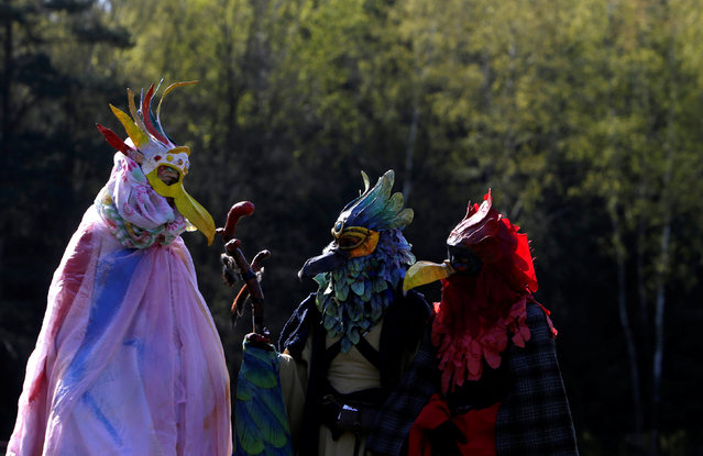 """People dressed as characters from the computer game """"World of Warcraft"""" stand in a forest near the village of Sosnova, Czech Republic, April 30, 2016. (Photo by David W. Cerny/Reuters)"""