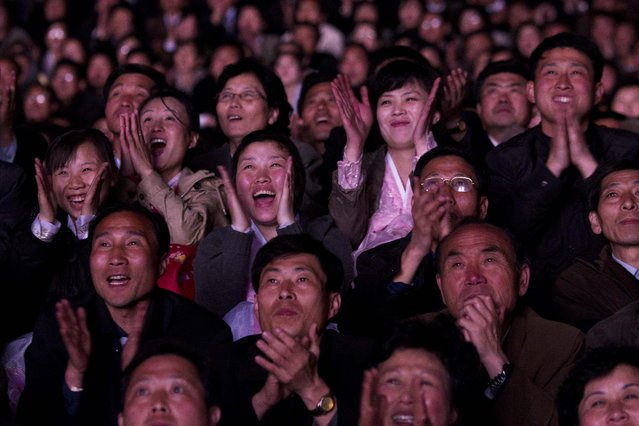 North Koreans look up with delight as they watch a fireworks display along the Taedong River in Pyongyang to celebrate 100 years since the birth of the late North Korean founder Kim Il Sung on Sunday, April 15, 2012. (Photo by David Guttenfelder/AP Photo)