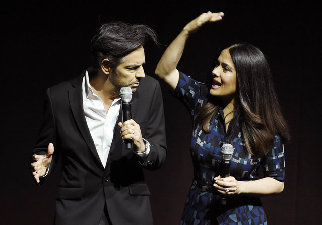 """Salma Hayek, right, a cast member in the upcoming film """"How to Be a Latin Lover"""", playfully slaps fellow cast member Eugenio Derbez as they discuss the film during the Lionsgate presentation at CinemaCon 2017 at Caesars Palace on Thursday, March 30, 2017, in Las Vegas. (Photo by Chris Pizzello/Invision/AP Photo)"""