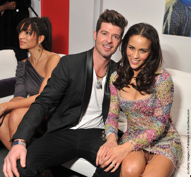 Singer Robin Thicke and actress Paula Patton attend the Mission: Impossible - Ghost Protocol U.S. premiere