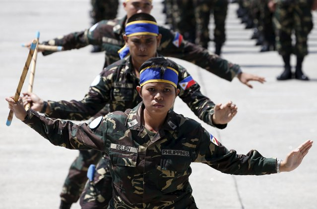 Armed Forces of the Philippines personnel deploying to the United Nations peacekeeping mission in Haiti, demonstrate their local martial arts skills, during a sending-off ceremony at the Villamor air base in Pasay city, Metro Manila July 7, 2015. (Photo by Erik De Castro/Reuters)