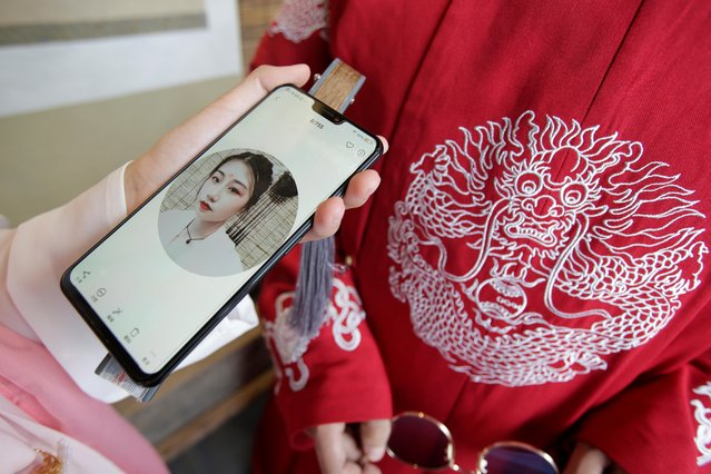 """Lu Xiaowei shows a selfie taken while she was dressed in """"Hanfu"""", or Han clothing, in Beijing, China, August 18, 2019. (Photo by Jason Lee/Reuters)"""