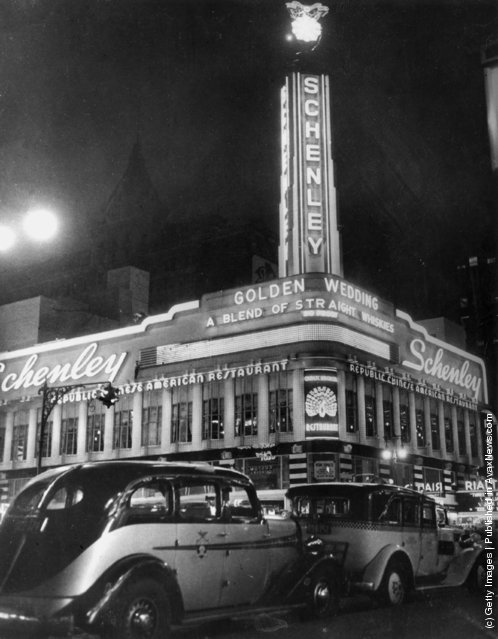 1936:  Schenley's, a Chinese restaurant in New York's Times Square, lit up at nighttime