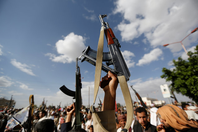 Followers of the Houthi movement hold up their rifles during a demonstration against the U.S. intervention in Yemen, in the country's capital Sanaa May 13, 2016. (Photo by Khaled Abdullah/Reuters)