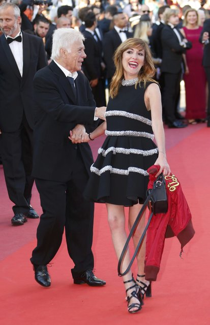 "French humorist Guy Bedos (L) and his daughter, writer and actress Victoria Bedos pose on red carpet as they arrive for the screening of the film ""Julieta"" in competition at the 69th Cannes Film Festival in Cannes, France, May 17, 2016. (Photo by Yves Herman/Reuters)"