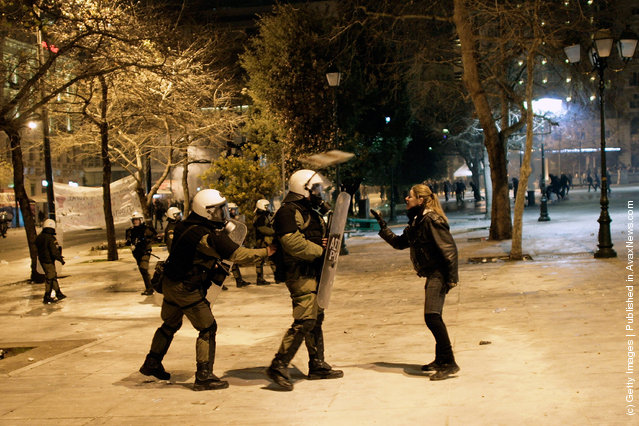 Demonstrators shouts at riot police during violent protests in central Athens