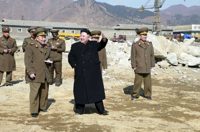 North Korean leader Kim Jong Un (C) gives field guidance to the construction site of the May 27 Fishery Station in this undated photo released by North Korea's Korean Central News Agency (KCNA) in Pyongyang March 14, 2015. (Photo by Reuters/KCNA)