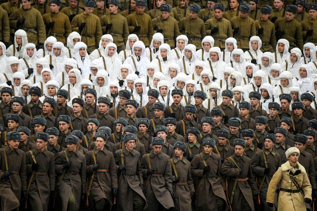 Russian servicemen dressed in historical uniforms rehearse for a forthcoming parade on Red Square in Moscow on November 5, 2019. The event will take place on November 7, marking the 78th anniversary of the 1941 parade, when Red Army soldiers marched past the Kremlin walls towards the front line to fight the Nazi Germany troops during World War Two. (Photo by Kirill Kudryavtsev/AFP Photo)