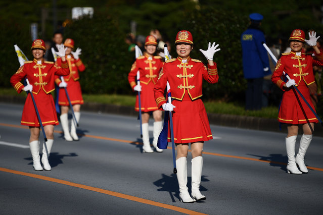 Participants take part in a parade to mark the enthronement of Japan's Emperor Naruhito in front of the Imperial Palace in Tokyo on November 9, 2019. (Photo by Charly Triballeau/AFP Photo)