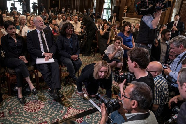 """Opposition Labour Party leader Jeremy Corbyn (C-R) sits with his wife, Laura Alvarez (L); Shadow Attorney General for England and Wales, Shami Chakrabarti (C-L) and Shadow Home Secretary, Diane Abbott (R) as he arrives to make a speech on defence on May 26, 2017 in London, England. Mr Corbyn stated that UK foreign policy would change under a Labour government to one that """"reduces rather than increases the threat"""" to the country, as election campaigning resumed after the attack in Manchester earlier this week. (Photo by Sean Smith/The Guardian)"""
