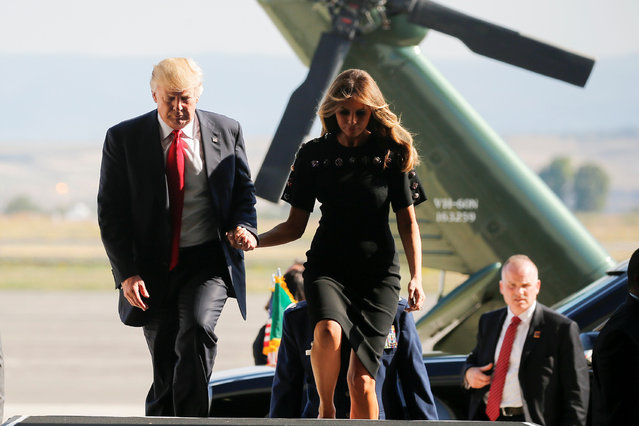 U.S. President Donald Trump and first lady Melania Trump hold hands as they arrive at the Naval Air Station Sigonella to visit U.S. troops before returning to Washington D.C. at Sigonella Air Force Base in Sigonella, Sicily, Italy, May 27, 2017. (Photo by Jonathan Ernst/Reuters)