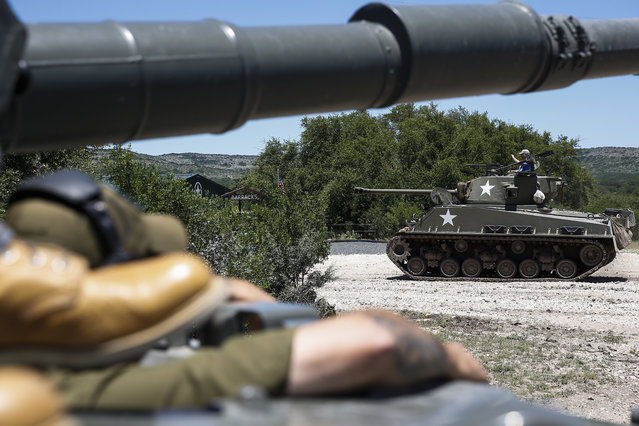 In this May 24, 2017, photo,  a tank passes by an other tank at Ox Ranch in Uvalde, Texas. (Photo by Michael Ciaglo/Houston Chronicle via AP Photo)