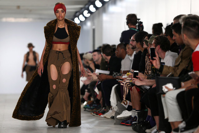 A model presents a creation at the Nasir Mazhar catwalk show at London Collections Men in London, Britain June 11, 2016. (Photo by Neil Hall/Reuters)