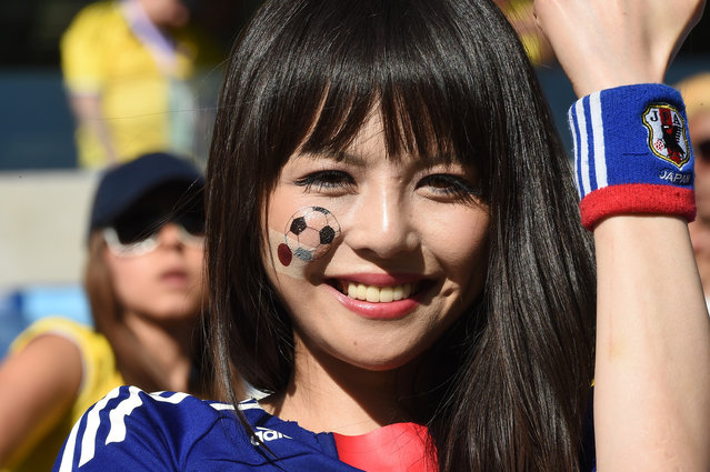 A Japan's fan waits for the start of a Group C football match between Japan and Colombia at the Pantanal Arena in Cuiaba during the 2014 FIFA World Cup on June 24, 2014. (Photo by Luis Acosta/AFP Photo)