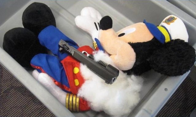 A handout photo provided by the Transportation Security Administration (TSA) shows parts of a pistol which were found hidden in a stuffed animal at T.F. Green Airport in Warwick, Rhode Island on May 8, 2012. (Photo by Reuters/TSA)