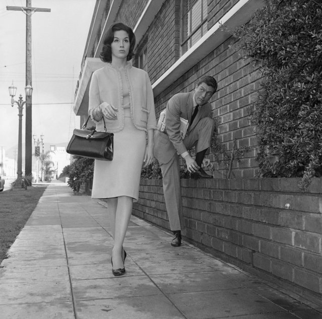 Actor Dick Van Dyke, right, looks on as actress Mary Tyler Moore walks by, February 22, 1962, Los Angeles, Calif. (Photo by Don Brinn/AP Photo)
