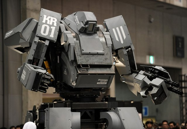 """Japanese electronics company Suidobashi Heavy Industry unveils its latest robot """"Kuratas"""" at the Wonder Festival in Chiba, suburban Tokyo on July 29, 2012. The Kuratas robot, which will go on sale with a price tag of one million USD, measures four meters in height, weighs four tons and has four wheeled legs that can either be controlled remotely through the 3G network or by a human seated within the cockpit."""
