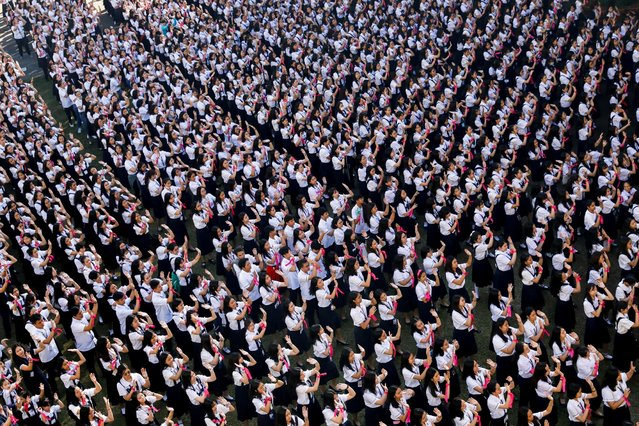 Thousands of Filipino students dance to take part in the One Billion Rising global campaign to end violence against women and children, during the Valentine's Day celebration at St Scholastica's College in Manila, Philippines, February 14, 2020. (Photo by Eloisa Lopez/Reuters)