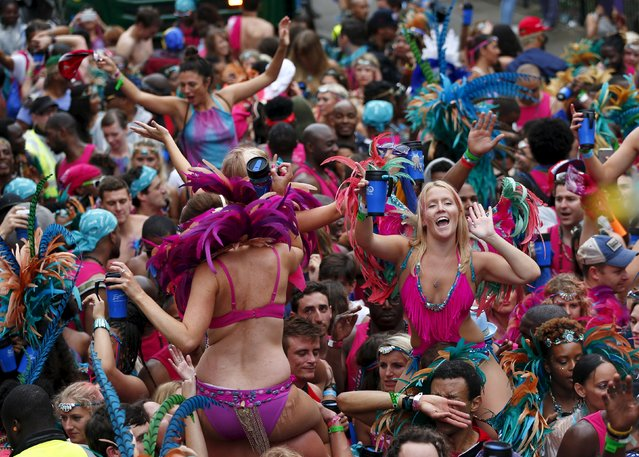 Revellers dance at the Notting Hill Carnival in west London, August 31, 2015. (Photo by Eddie Keogh/Reuters)
