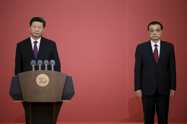 China's President Xi Jinping (L) and Premier Li Keqiang attend a medal ceremony marking the 70th anniversary of the Victory of Chinese People's War of Resistance Against Japanese Aggression, for World War Two veterans, at the Great Hall of the People in Beijing, China September 2, 2015. (Photo by Jason Lee/Reuters)