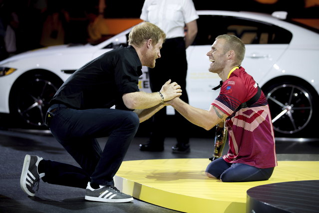 Prince Harry congratulates Mark Ormrod, of the U.K., on his silver medal in indoor rowing at the Invictus Games in Toronto on Tuesday, September 26, 2017. (Chris Donovan/The Canadian Press via AP Photo)