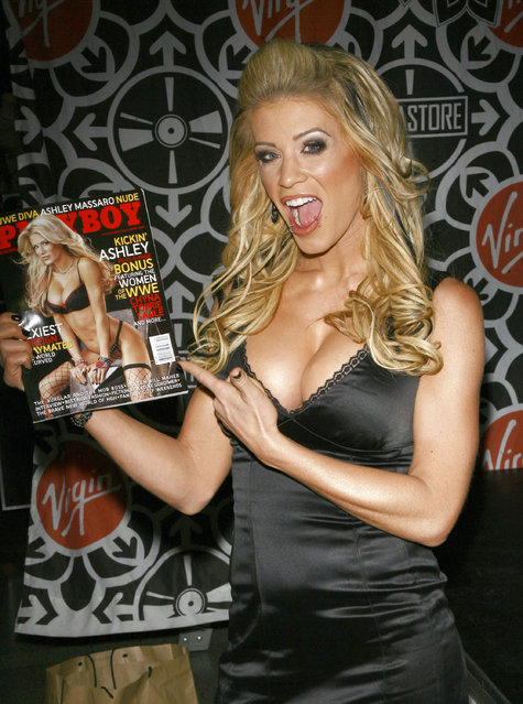 """WWE star Ashley Massaro during Ashley Massaro Signs the April 2007 Issue of """"Playboy"""" at Virgin Megastore in Times Square – March 8, 2007 at Virgin Megastore Times Square in New York City, New York, United States. (Photo by Jemal Countess/WireImage)"""