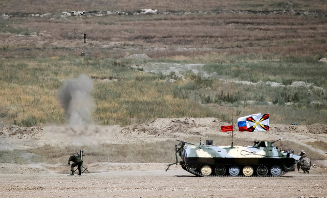 Russia's army crew fires a mortar next to their Light Multi-Purpose Armoured Towing Vehicle during mortar units competition at the International Army Games 2016 at Gvardeisky Range, Kazakhstan, August 2, 2016. (Photo by Shamil Zhumatov/Reuters)