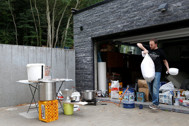 Simon Royer, medical student and member of the Belgian Homebrewers association, sets up his brewing equipment to make his own beer outside his parents garage in Wepion, Belgium, August 11, 2016. (Photo by Francois Lenoir/Reuters)