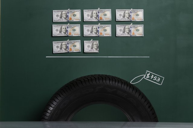 A Goodyear brand automobile tyre as photographed in a studio with an illustrative price tag of $753 (US dollars), equivalent to the Bs. 4,750 (bolivars) that it costs on average to purchase in Caracas at the official exchange rate of 6.3 bolivars per dollar, in Caracas September 29, 2014. (Photo by Carlos Garcia Rawlins/Reuters)