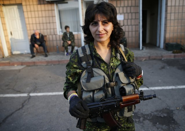 A Ukrainian servicewoman Stella, 33, poses for a picture in the village of Schastya, near the eastern Ukrainian town of Luhansk, September 26, 2014. (Photo by David Mdzinarishvili/Reuters)