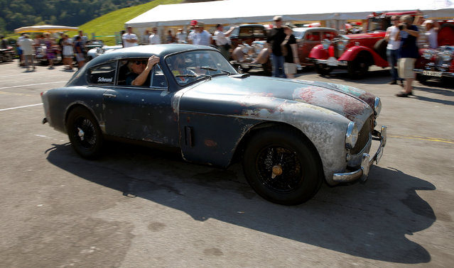 Participants arrive in their vintage Aston Martin DB 2 sports car during the British Car Meeting 2016 in the village of Mollis, Switzerland August 28, 2016. (Photo by Arnd Wiegmann/Reuters)