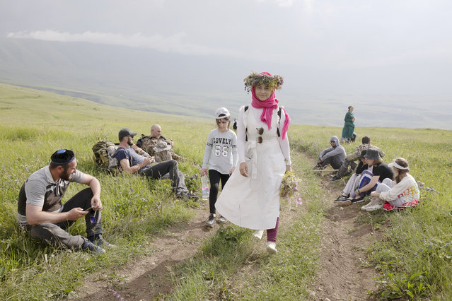 People take part in a free hike organized by the Tourism Ministry of the Chechen Republic to mark the lifting of the self-isolation regime and the start of the hiking season in Chechen Republic, Russia on July 4, 2020. The 11-kilometer route runs from Lake Kezenoi-Am to the ancient village of Kharkaroi. (Photo by Yelena Afonina/TASS)