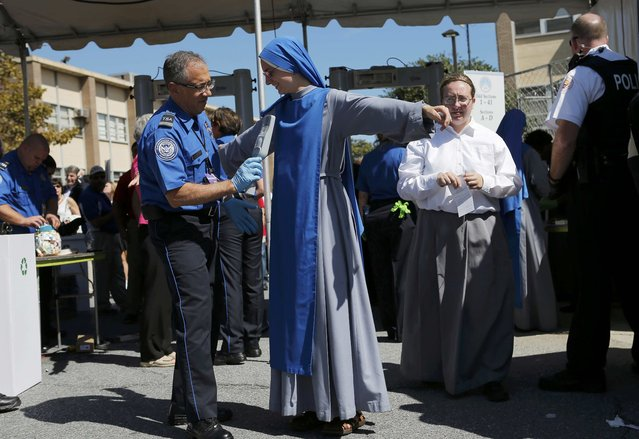 Sister Marie of Washington passes through security before Pope Francis holds the Canonization Mass for Friar Junipero Serra at the Basilica of the National Shrine of the Immaculate Conception in Washington September 23, 2015. (Photo by Brian Snyder/Reuters)