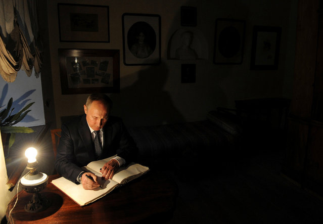 Russian President Vladimir Putin signs a visitors' book at Russian writer Leo Tolstoy estate museum in Yasnaya Polyana outside the city of Tula, Russia September 8, 2016. (Photo by Mikhail Klimentyev/Reuters)