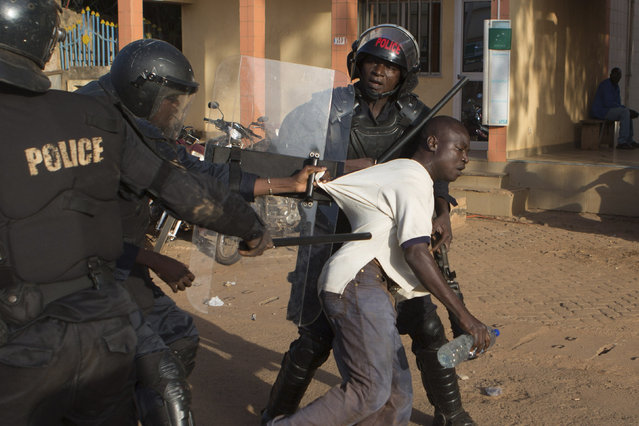 Police arrest an anti-government protester in Ouagadougou, capital of Burkina Faso, October 30, 2014. (Photo by Joe Penney/Reuters)
