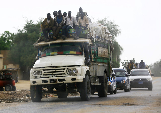 People are seen riding on top of a truck in Al Fashir, capital of North Darfur September 5, 2016. (Photo by Mohamed Nureldin Abdallah/Reuters)