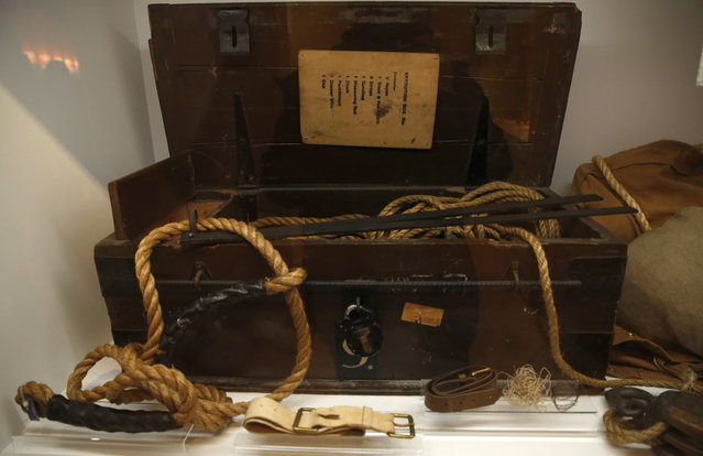 Execution box no. 9 from Wandsworth Prison, which was sent around the Britain to be used as required, is displayed as part of the Crime Museum Uncovered exhibition at the Museum of London in the City of London, Wednesday, October 7, 2015. A sticker on the box showed it was used in Jersey, on Oct. 9 1959 for the last execution in the Channels Islands, that of Francis Huchet. (Photo by Alastair Grant/AP Photo)