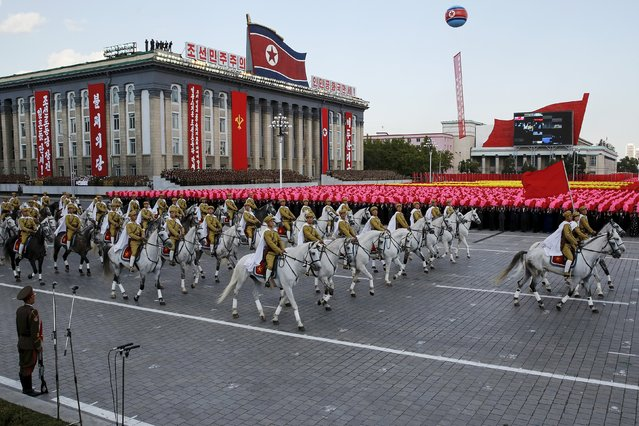 Soldiers ride horses past a stand with North Korean leader Kim Jong Un during the parade celebrating the 70th anniversary of the founding of the ruling Workers' Party of Korea, in Pyongyang October 10, 2015. (Photo by James Pearson/Reuters)