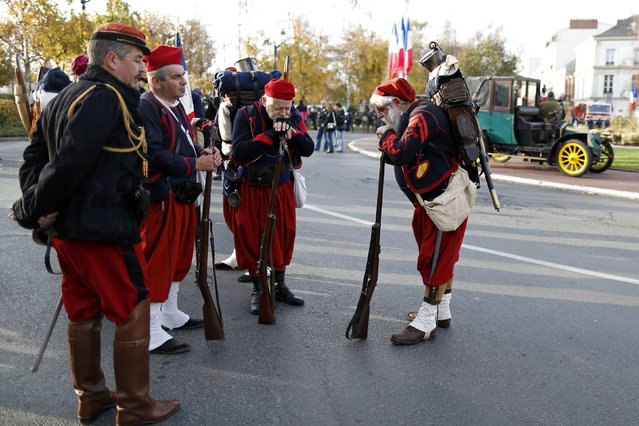 """History enthusiasts of French association """"Arquebusiers de l'Est"""", dressed as soldiers of 3rd regiment of Zouave, attend an Armistice Day ceremony to commemorate the end of World War One at Epernay, eastern France, November 11, 2014. (Photo by Charles Platiau/Reuters)"""