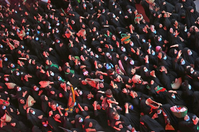 Iraqis take part in a ceremony as part of the Islamic mourning month of Muharram in the holy city of Karbala, on September 2, 2020. (Photo by Mohammed Sawaf/AFP Photo)